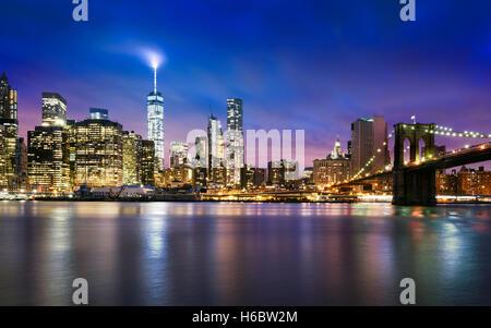 New York City - beautiful sunset over manhattan with manhattan and brooklyn bridge - Stock Photo