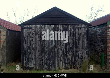 Dilapidated run down sheds still in use - Stock Photo
