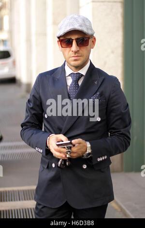 Amos Partemi posing outside the Salvatore Ferragamo Spring/Summer 2017 show during Milan Fashion Week in Milan, - Stock Photo