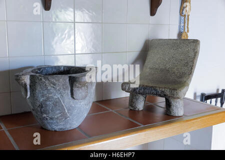 mortar and stone to knead in the kitchen - Stock Photo