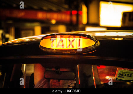 Black taxi cab sign in Soho, Central London, UK - Stock Photo