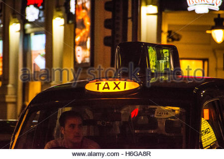 Black taxi cab sign in Chinatown, Soho, Central London, UK - Stock Photo