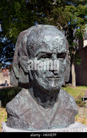 Bust of the artist Paul Delvaux, Belgian Surrealist, Veurne, West Flanders, Flanders, Belgium - Stock Photo