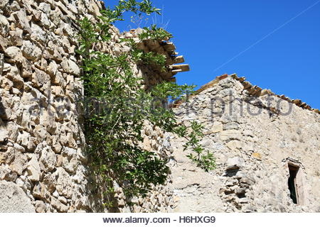Old uninhabited Village, Decayed Building ,Abandoned place, ancient homes decaying, countryside in southern France - Stock Photo