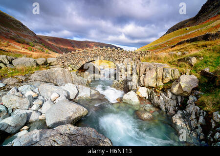 Stocley Bridge crossing the river Derwent near Seathwaite in the Lake District National Park in Cumbria. - Stock Photo
