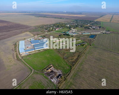 Top view of the village with houses and hangars for the storage of grain. - Stock Photo