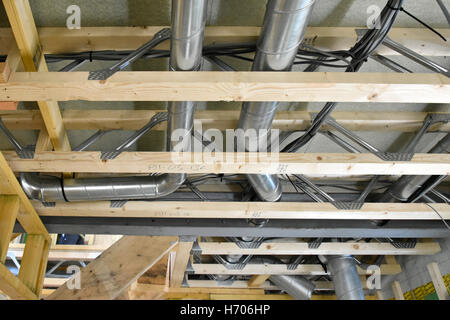 Interior of new UK energy efficient Passive House showing building materials & ventilation trunking installed within - Stock Photo