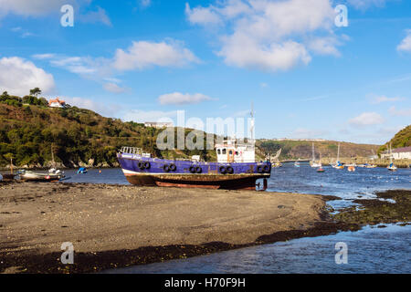 Old fishing boat beached in port on Afon Gwaun River estuary. Lower Fishguard (Abergwaun), Pembrokeshire, Wales, - Stock Photo