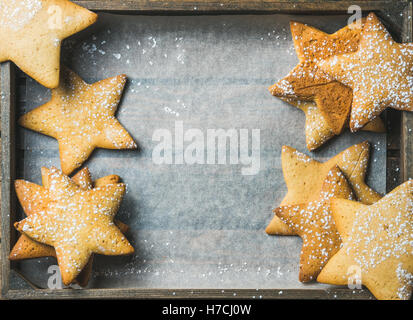 Sweet Christmas gingerbread cookies in shape of stars, copy space - Stock Photo