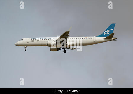 Montenegro Airlines Embraer ERJ-195LR on final approach - Stock Photo