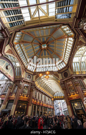 LONDON - NOVEMBER 3, 2016: Visitors gather under the Victorian arcade of the Leadenhall Market, a historic tourist - Stock Photo