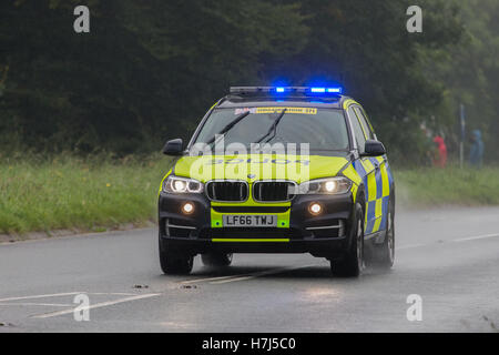 A Police Traffic car clearing the road for the Tour of Britain Cycle Race, about to enter Kendal - Stock Photo
