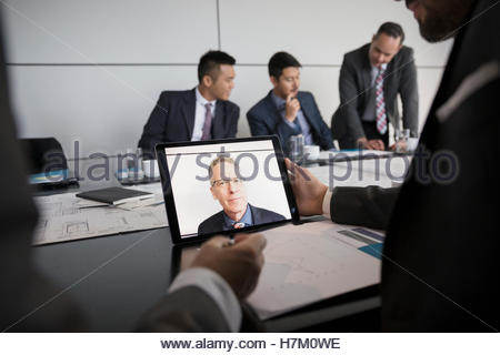 Male architect video conferencing on laptop in conference room - Stock Photo