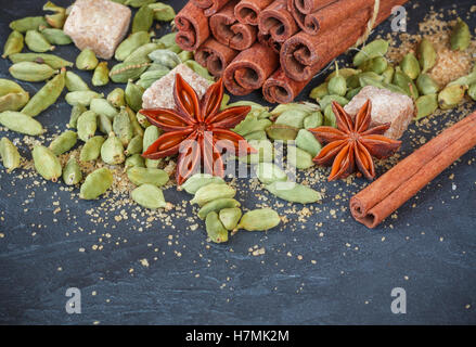 Spices. Cinnamon sticks, cardamom, star anise and brown sugar. The ingredients for Christmas baking. Copy space - Stock Photo