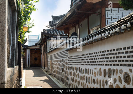 Small and empty alley and old buildings at the Bukchon Hanok Village in Seoul, South Korea. - Stock Photo