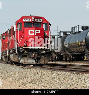 Canadian Pacific Railway locomotives tanker rail cars rail yard Medicine Hat, Alberta, Canada - Stock Photo