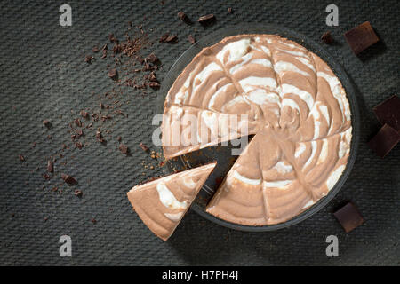 Chocolate ice cream cake on a stone gray background. Top view, copy space. - Stock Photo