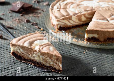 Chocolate ice cream cake Zebra on a gray stone background. Selective focus, close-up. - Stock Photo