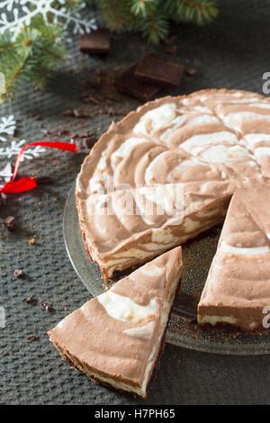 Chocolate ice cream cake Zebra on dark stone background. Christmas tree and decorations. - Stock Photo