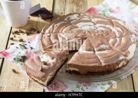Chocolate cake ice cream zebra on a wooden background. - Stock Photo