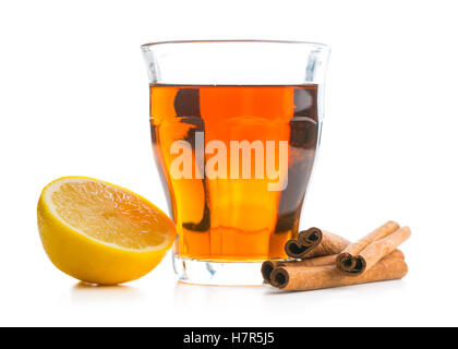 Tea in glass cup, lemon and cinnamon sticks isolated on white background. - Stock Photo