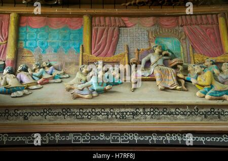 Yangon, Burma - 11 November 2014. Bas relief of Burmese king with subjects at the Shwedagon. - Stock Photo