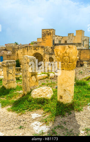 The ruins of the ancent columns decorated with carvings in archaeological site of the Roman baths, El Kef, Tunisia. - Stock Photo