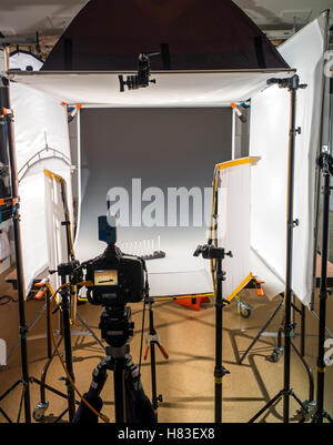Lighting and camera equipment in a commercial photography studio. - Stock Photo