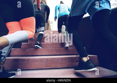 Close up view of several athletes running up the stairs while practising. Copyspace - Stock Photo