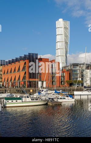 Turning Torso residential skyscraper and the Western Harbor ( Vastra hamnen ) district in Malmo, Sweden - Stock Photo