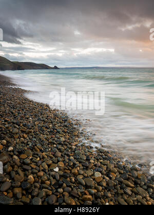 Newgale beach and waves across the pebbles, Pembrokeshire Coast National Park, Wales, UK - Stock Photo