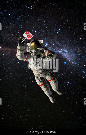 astronaut  in space holding for sale sign - Stock Photo