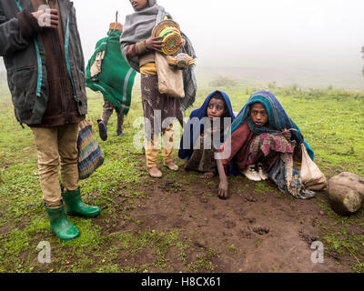 Children in Semien Mountains, Ethiopia, playing mancala game, on a foggy day. - Stock Photo
