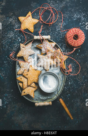 Christmas holiday star shaped gingerbread cookies for Christmas tree decoration, sieve, decorative snowflakes, balls - Stock Photo