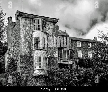 Spooky/scary looking house in Kinsale, County Cork, Ireland under a dramatic sky. - Stock Photo
