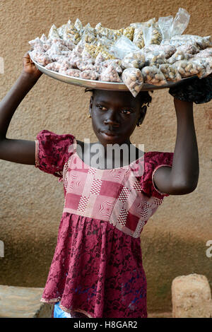 BURKINA FASO, Bobo Dioulasso, child labour, girl sell nuts / Kinderarbeit, Maedchen verkauft Erdnuesse - Stock Photo