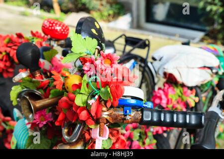 Brightly decorate bikes in Amsterdam - Stock Photo