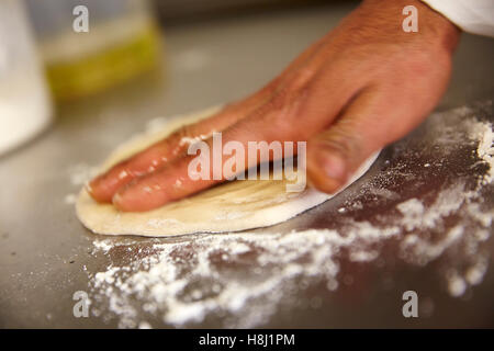 INDIAN RESTAURANT FOOD PREPARATION NAN BREAD OVEN - Stock Photo