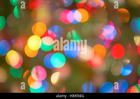 A background of colourful Christmas lights, thrown out of focus - Stock Photo