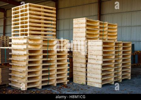 Brakne Hoby, Sweden - October 29, 2016: Documentary of local industrial area. Outdoor pallet storage area under - Stock Photo