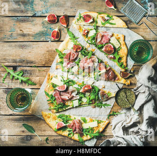 Homemade sage flatbread pizza with rose wine in glasses - Stock Photo