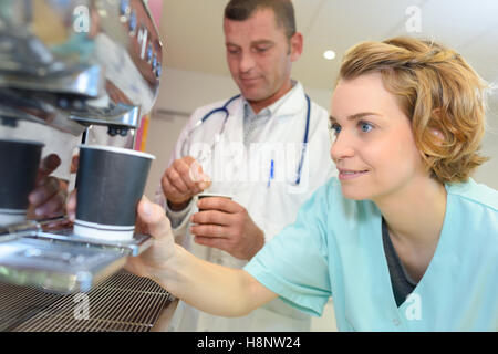 young team of doctors having coffee break at hospital - Stock Photo