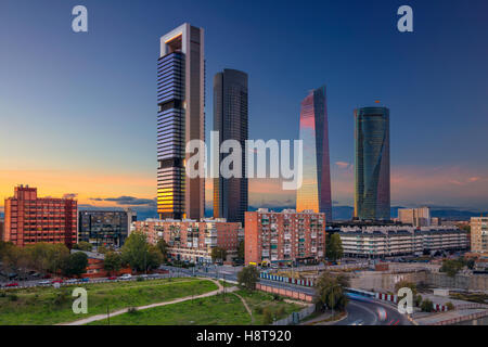 Madrid. Image of Madrid, Spain financial district with modern skyscrapers during sunset. - Stock Photo