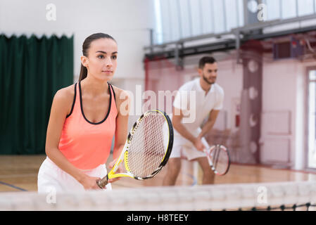 Professional players playing tennis - Stock Photo