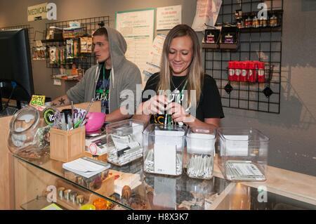 Individual marijuana joint is most popular item in marijuana dispensary. Denver, CO - Stock Photo