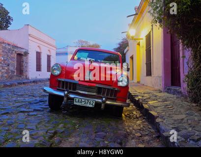 Uruguay, Colonia Department, Colonia del Sacramento, Vintage Studebaker car on the cobblestone lane of the historic - Stock Photo