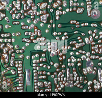 Circuit board that shows signs of age and heating - Stock Photo