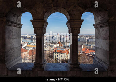 View of Hungarian Parliament and city panorama from Fisherman's Bastion window in Budapest, Hungary - Stock Photo
