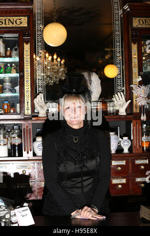 Haworth, UK. 19th Nov, 2016. A women dressed in black inside the apothecary, Haworth, 19th November 2016. Credit: - Stock Photo
