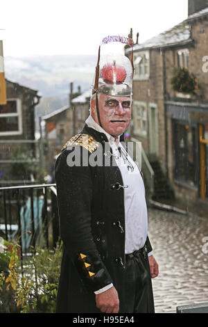 Haworth, UK. 19th Nov, 2016. A man in a costume with brains on top of his head, Haworth, 19th November 2016. Credit: - Stock Photo